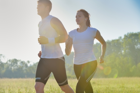Photo for Young couple jogging in park at morning. Health and fitness concept - Royalty Free Image