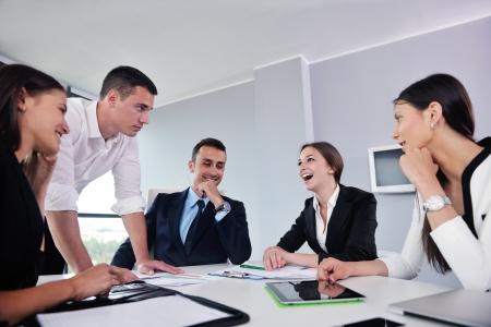 Photo for Group of happy young  business people in a meeting at office - Royalty Free Image