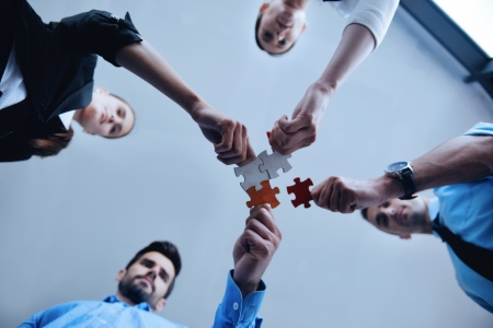 Foto für Group of business people assembling jigsaw puzzle and represent team support and help concept - Lizenzfreies Bild