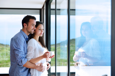 Foto de romantic happy young couple relax at modern home indoors - Imagen libre de derechos