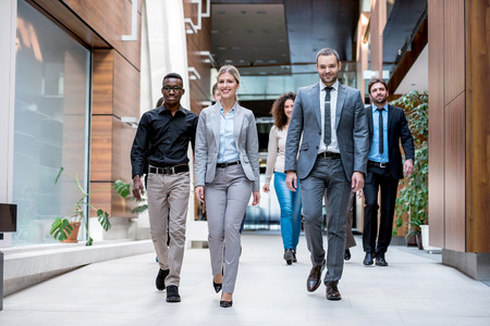 Foto per young multi ethnic business people group walking standing and top view - Immagine Royalty Free