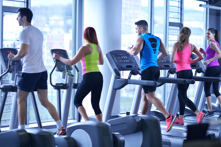 Photo pour group of young people running on treadmills in modern sport  gym - image libre de droit