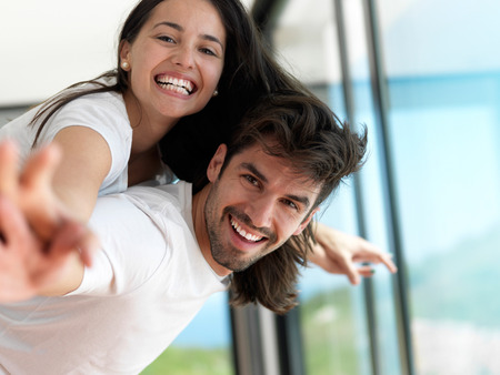 Foto de romantic happy young couple relax at modern home indoors and have fun - Imagen libre de derechos