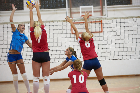 Photo pour volleyball game sport with group of young beautiful girls indoor in sport arena school gym - image libre de droit