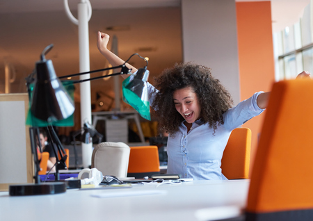 Photo for happy young curly  business woman in the modern office - Royalty Free Image