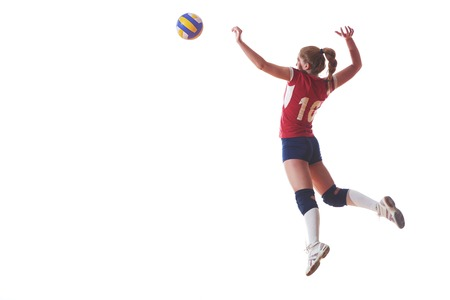Photo pour volleyball woman jump and kick ball isolated on white background - image libre de droit