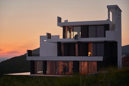 Foto de External view of a contemporary house modern villa at  sunset - Imagen libre de derechos
