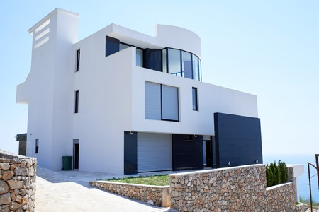 Foto de External view of a contemporary house modern villa at  sunset - Imagen libre de derechos
