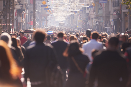Photo for people crowd walking on busy street on daytime - Royalty Free Image