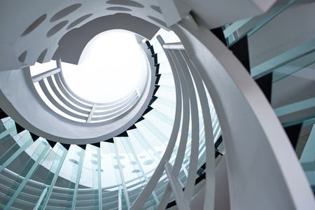 Photo pour modern glass spiral staircase with metallic hand-rails. - image libre de droit