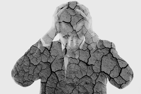 Photo pour double exposure of depressed business man and dry ground background - image libre de droit