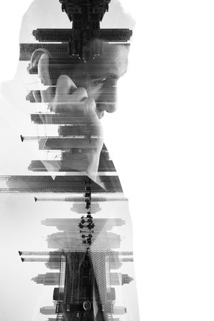 double exposure of business man with  mobile phone and city buildings background. abstract design idea