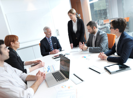 Photo for business people group on meeting at modern bright office indoors. Senior  businessman as leader in discussion. - Royalty Free Image