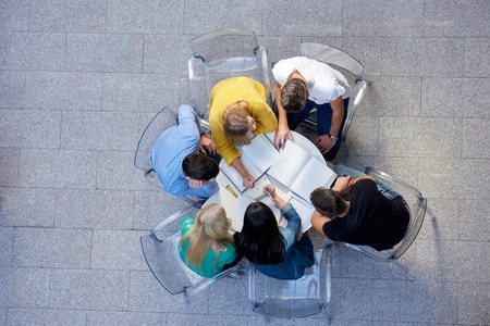Photo for top view,  group of students together  at school table working homework and have fun - Royalty Free Image