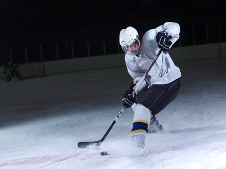 Photo pour ice hockey player in action kicking with stick - image libre de droit