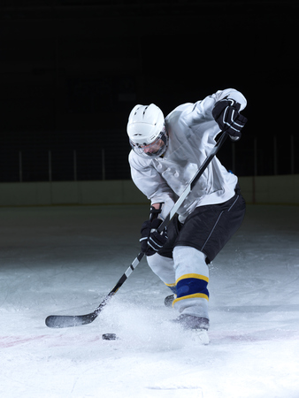 Foto per ice hockey player in action kicking with stick - Immagine Royalty Free