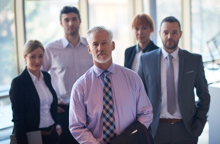 Photo for senior businessman with his team at office. business people group - Royalty Free Image