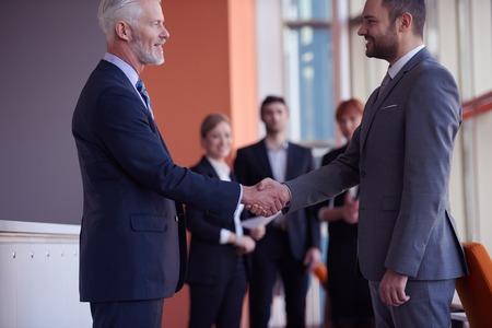 Photo pour business partners, partnership concept with two businessman handshake - image libre de droit