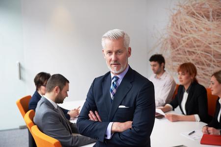 Foto de senior businessman with his team at modern office. business people group - Imagen libre de derechos