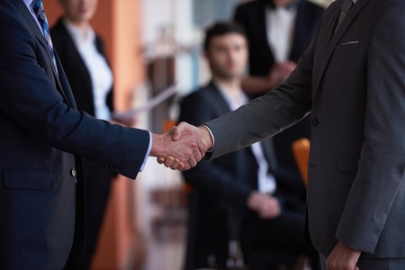 Photo for business partners, partnership concept with two businessman handshake - Royalty Free Image