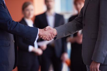 Foto de business partners, partnership concept with two businessman handshake - Imagen libre de derechos