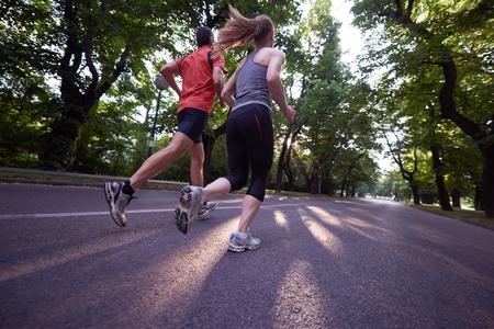 Photo pour urban sports healthy couple jogging - image libre de droit