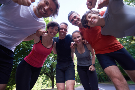 Photo pour jogging people group, friends have fun,  hug and stack hands together after training - image libre de droit