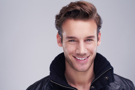 Foto de handsome young man portrait isolated on white background in studio - Imagen libre de derechos