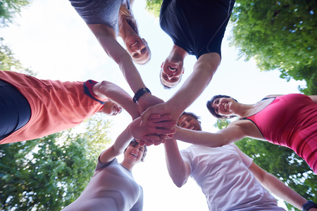 Photo for jogging people group, friends have fun,  hug and stack hands together after training - Royalty Free Image