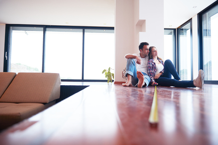 Photo for happy young romantic couple at new modern  home interior renovation - Royalty Free Image