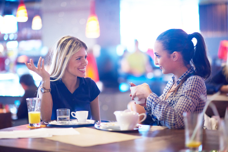 Photo for happy girl friends have cup of coffee in modern city restaurant - Royalty Free Image