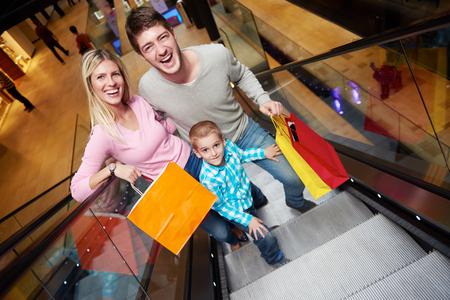 Foto de happy young family portrait in shopping mall - Imagen libre de derechos