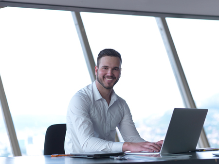 Foto de happy young business man work and relax at modern bright office interior, hipster with beard at workplace - Imagen libre de derechos