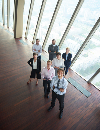 Foto de diverse business people group standing together as team  in modern bright office interior - Imagen libre de derechos