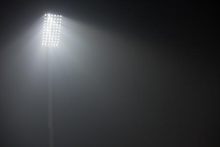 Photo pour soccer stadium lights reflectors against black background - image libre de droit