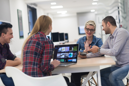 Photo for startup business team on meeting in modern bright office interior brainstorming, working on laptop and tablet computer - Royalty Free Image