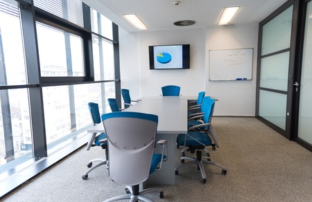 Foto de interior of new modern office meeting room with big windows - Imagen libre de derechos