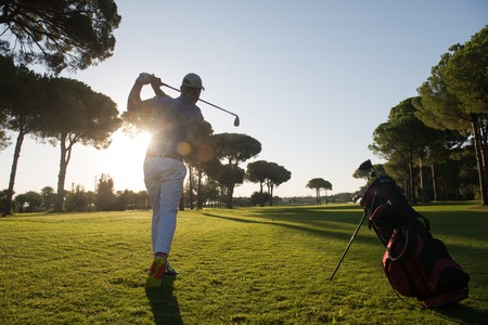 Photo pour golf player hitting shot with driver on course at beautiful sunny day - image libre de droit