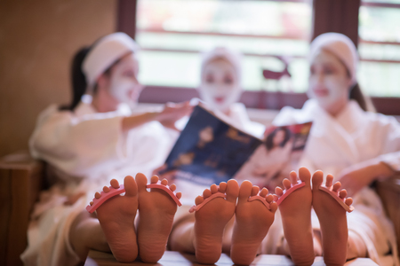 Photo pour group of famale friends in spa have fun, celebrate bachelorette party with face mask - image libre de droit