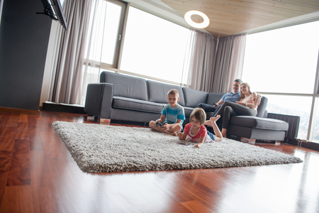 Photo pour Happy Young Family Playing Together at home - image libre de droit