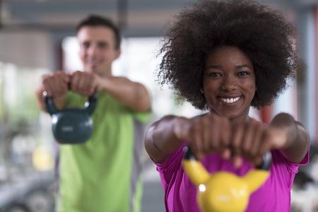 Photo for healthy couple  workout with weights lifting  dumbbels at  crossfit gym african  american woman with afro hairstyle - Royalty Free Image