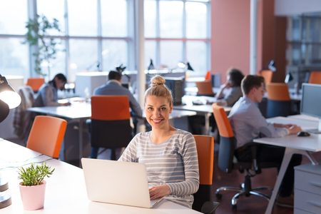 Photo for Young female Entrepreneur Freelancer Working Using A Laptop In Coworking space - Royalty Free Image
