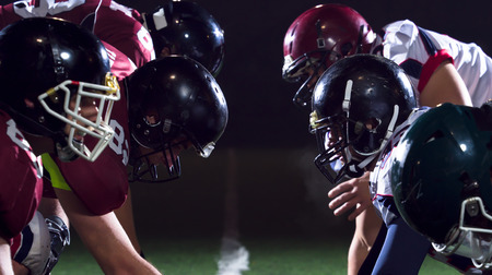 Photo pour american football players are ready to start on field at night - image libre de droit