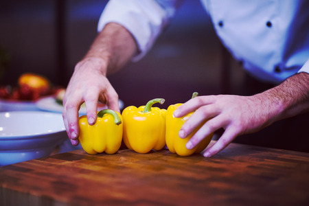 Photo for chef holding fresh peppers for vegetable salad in restaurant kitchen - Royalty Free Image