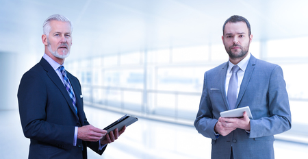 Photo for Portrait of two colleague businessmans using tablet in front of the modern IT company - Royalty Free Image