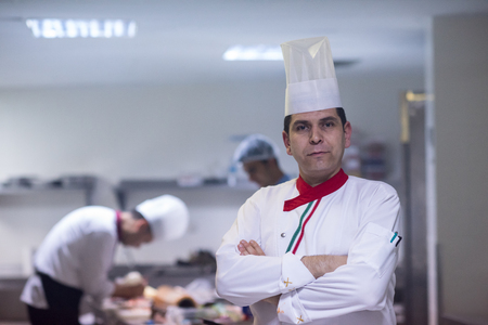 Photo for Portrait of young chef standing in commercial kitchen at restaurant - Royalty Free Image