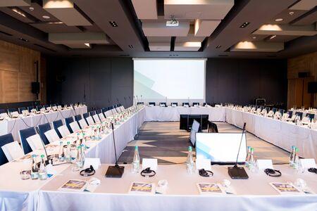 Foto de interior of big modern conference room before starting a business seminar - Imagen libre de derechos