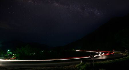 Photo for vegicle light trails in night on busy countryroad curve  long exposure - Royalty Free Image