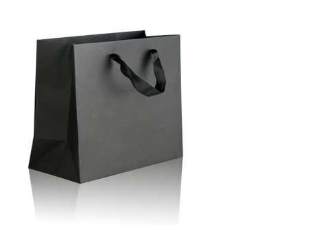 Photo pour Black shopping bag on white. - image libre de droit
