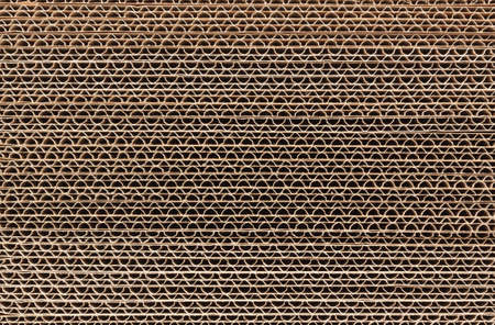 Foto de Stack of corrugated cardboard in a large pile - Imagen libre de derechos